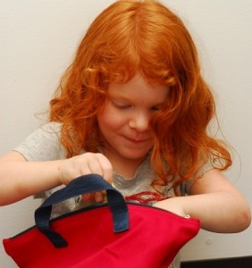 Girl with red bag
