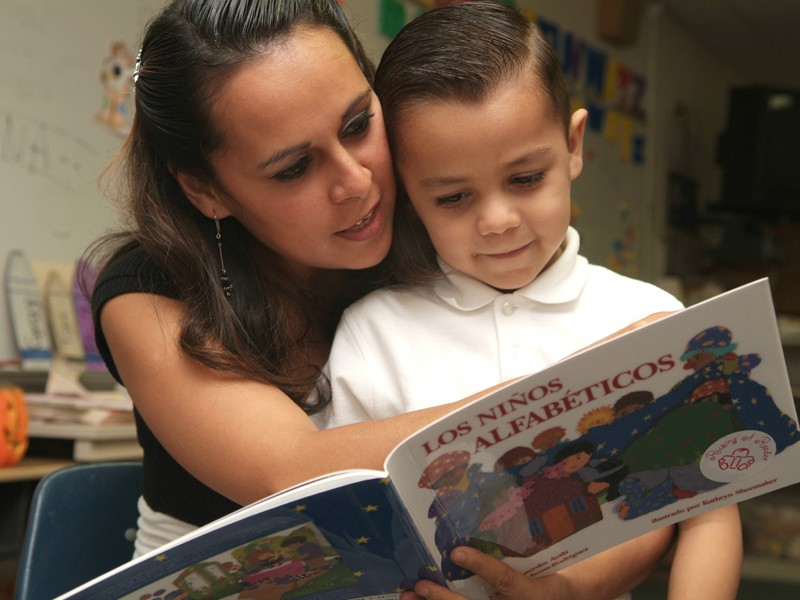Boy and mom reading