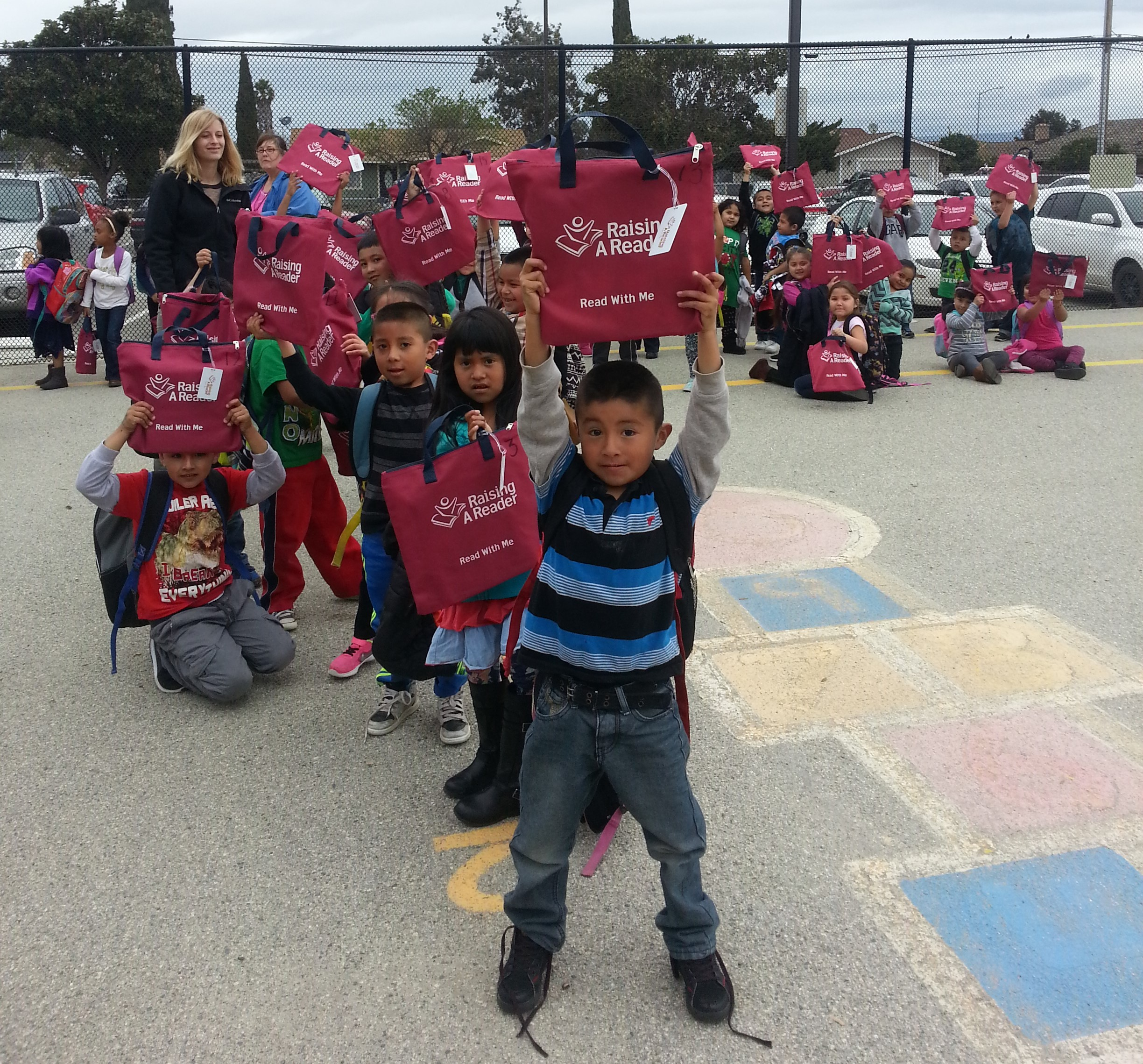 Image of Schoolyard Kids with red raising a reader bags Bags square